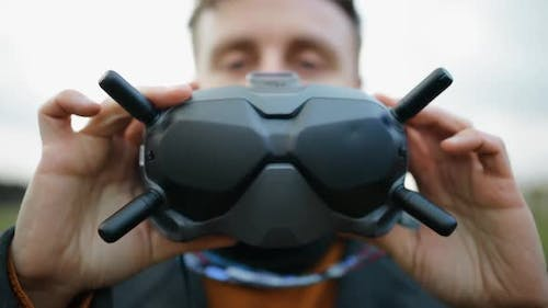 Young Man Looking Into Modern FPV Drone Goggles