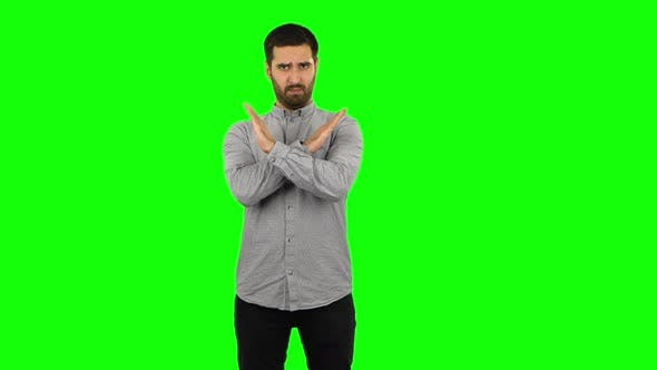 Thumbnail for Brunette Guy Strictly Gesturing with Hands Crossed Making X Shape Meaning Denial Saying NO. Green