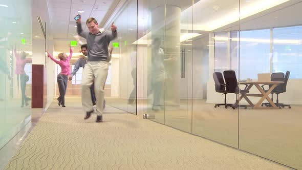 Thumbnail for Businesspeople dancing down hallway