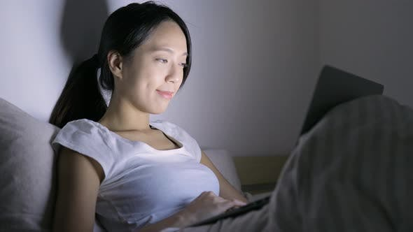 Thumbnail for Woman use of laptop computer on bed