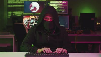 Unrecognizable Hacker Making Code