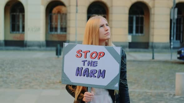 Thumbnail for Blonde Woman Protesting To Stop Harm By Holding Steamer