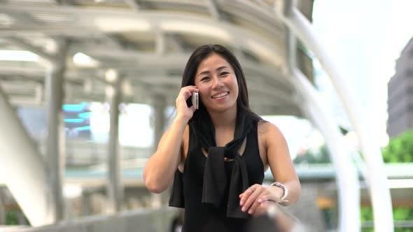 Thumbnail for Asian Woman Phone Call
