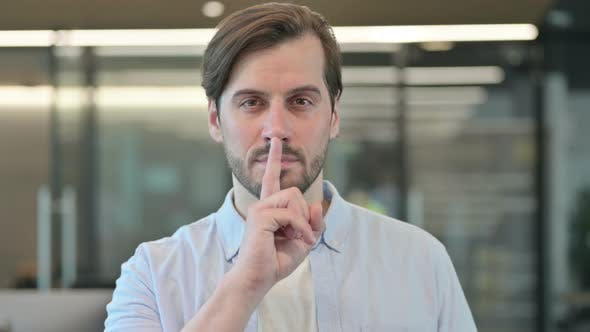 Man Showing Quiet Sign Finger on Lips