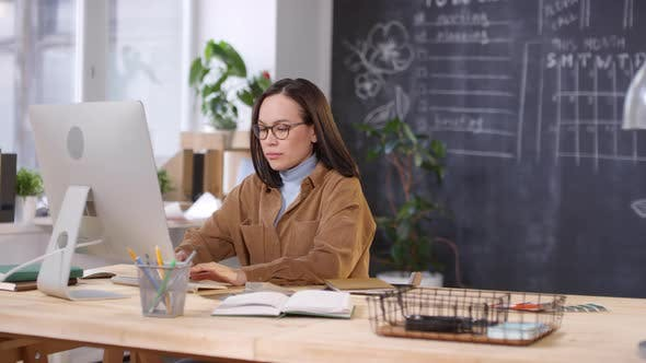 Thumbnail for Asian Woman in Glasses Working in Office