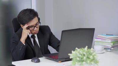 young business man working problem using laptop
