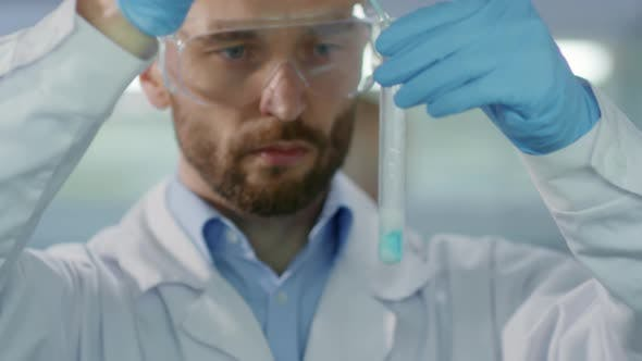 Thumbnail for Male Researcher Performing Test in Lab