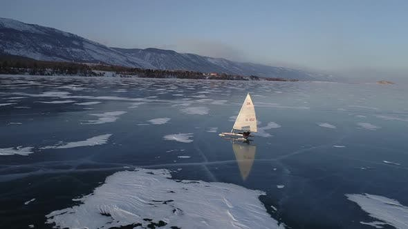 Thumbnail for Sailing Ships Yacht Skates on Ice Skate. Ice-boat Sailing on Lake Baikal