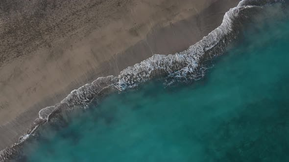 Cover Image for Top View of the Desert Black Beach on the Atlantic Ocean. Coast of the Island of Tenerife. Aerial