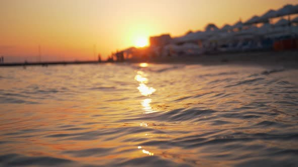 Cover Image for Summer Scene of Sea and Resort at Golden Sunset