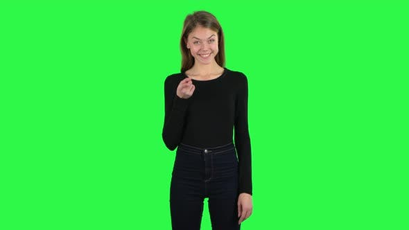 Cover Image for Young Woman Listens Carefully, Threatens with a Finger and Waves Her Head Seductively. Green Screen