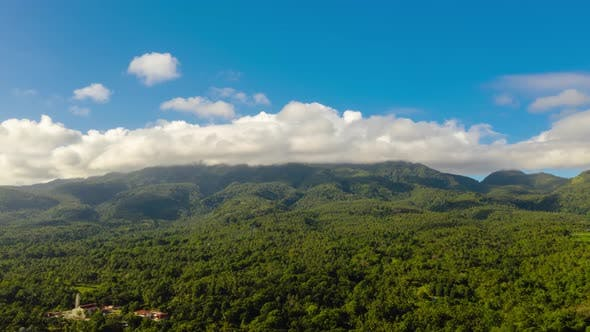 Time Lapse Mountains Covered with Rainforest Philippines Camiguin