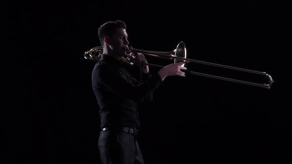 Thumbnail for Man Plays on Wind Instrument Tranquil Melody in Slow Motion