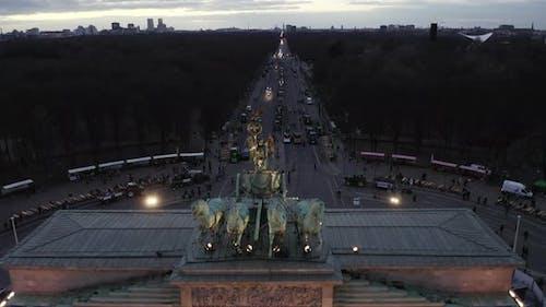 AERIAL: Close Up of Quadriga Green Statue on Brandenburger Tor in Berlin, Germany on Sunset