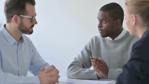 Professional African Businessman Having Discussion with Colleagues