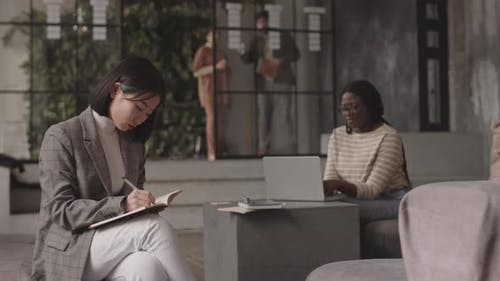 Asian Woman Writing and Posing