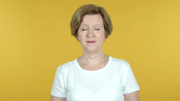 Old Woman Inviting Customers with Both Hands Isolated on Yellow Background