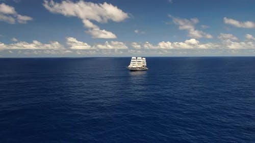 Sailing ship in the open ocean. Travel. Freedom.  Aerial 4k.