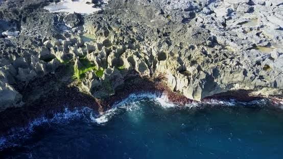 Aerial drone view of rocky tide pools coastline