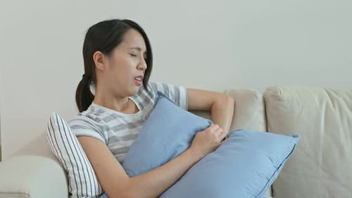 Woman Suffer from Stomach at Home