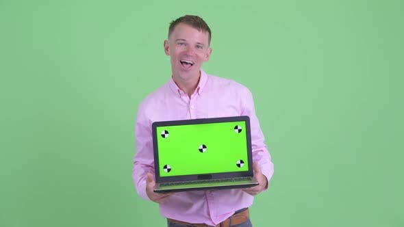 Cover Image for Happy Businessman Showing Laptop and Looking Surprised