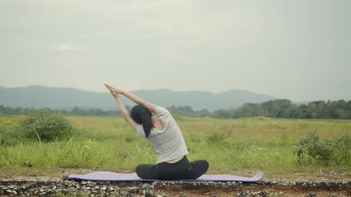 Beautiful caucasian female sitting in meditation pose position yoga pranayama balance.