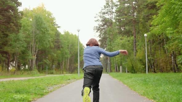 Teenager Boy Skateboarding on Skateboard in Summer City Park Track Shot