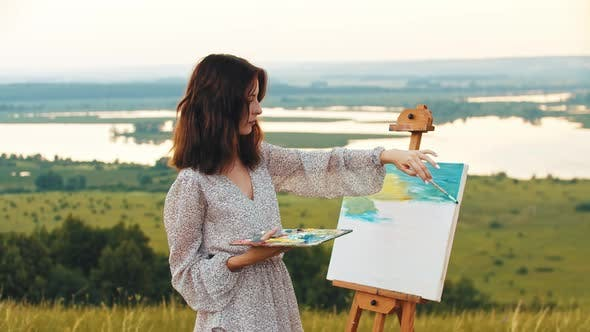 Young Woman Drawing a Painting Inspired By Nature