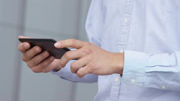 Thumbnail for Closeup shot of businessman using digital tablet
