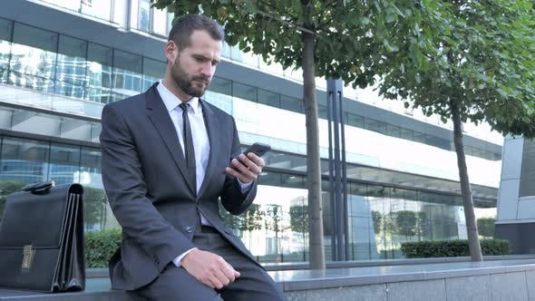 Thumbnail for Businessman Using Smartphone for Reading Email
