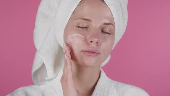 Thumbnail for Beautiful Woman Applying Cream to Face after Shower