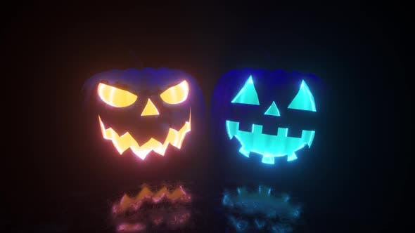 Thumbnail for Halloween, Two Pumpkins with a Scary Face Glow From the Inside in Two Different Colors. Bright Neon