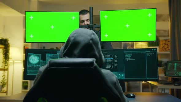 Team of Hackers Using Computer with Green Screen Mockup