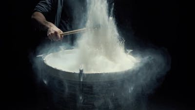 Slow Motion Drums Game on a Dusty Drum Close Up