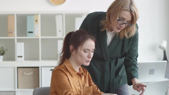 Thumbnail for Middle-Aged Female Manager Advising Young Trainee
