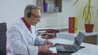 Doctor during online consultation. Online video conference call with doctor on laptop