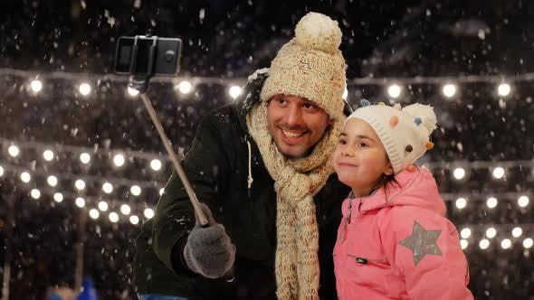 Thumbnail for Father and Daughter Taking Selfie on Skating Rink