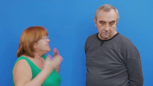 Couple Arguing- Elderly Couple Quarrels Accusing Each Other.
