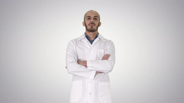 Thumbnail for Serious Arabian Doctor Mature Male with Crossed Arms on Gradient Background.