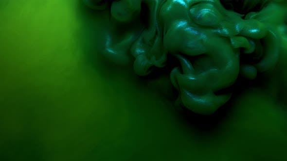 Thumbnail for Colorful Green Ink Drops From Above Mixing in Water, Swirling Softly Underwater on Black Background