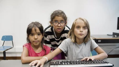 Girls Looking at Monitor and Learning Computer Science
