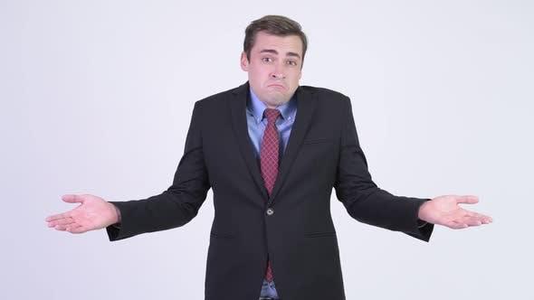 Cover Image for Young Handsome Businessman Shrugging Shoulders
