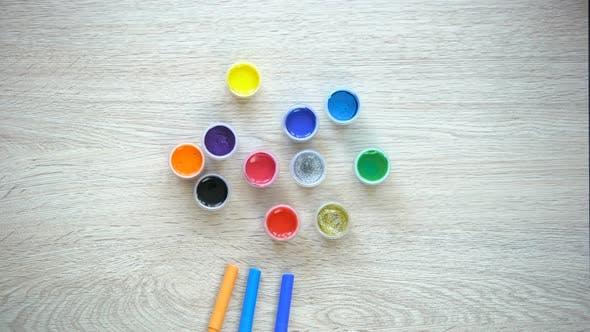 Thumbnail for Colorful Felt-Tip Pens and Paints Forming Sun-Figure, Children Rehabilitation