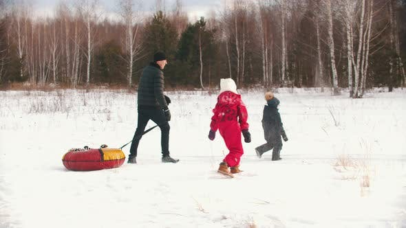 Thumbnail for Family Playing with Snow Outdoors