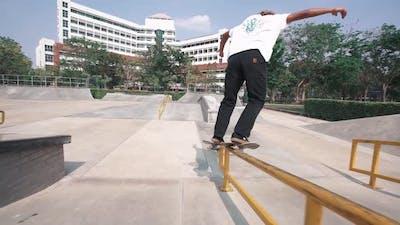 Skater Grinding Rail At Skatepark