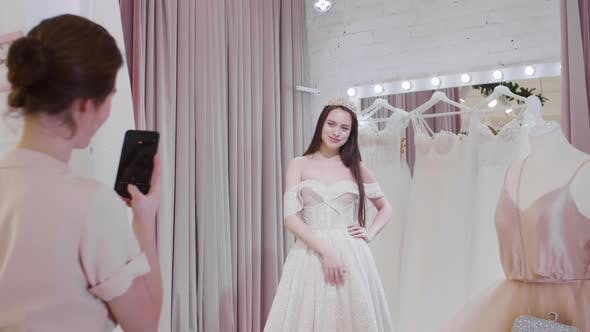 Thumbnail for Woman Making Photos of Bride in Wedding Store