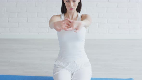 Thumbnail for Beautiful Woman Stretching Arms While Doing Yoga