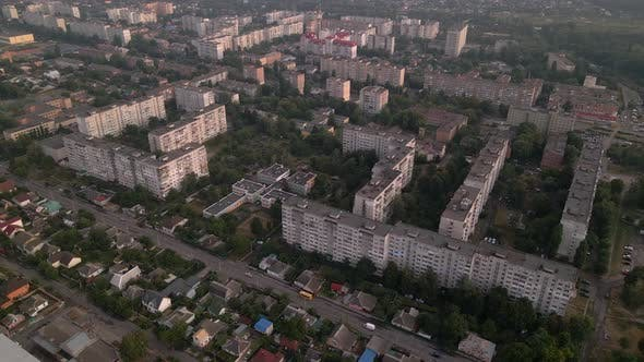 Thumbnail for Drone Flying Over Apartment Buildings and Street in Small European City at Summer Evening
