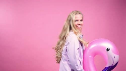 Teenage Girl Riding Inflatable Animal