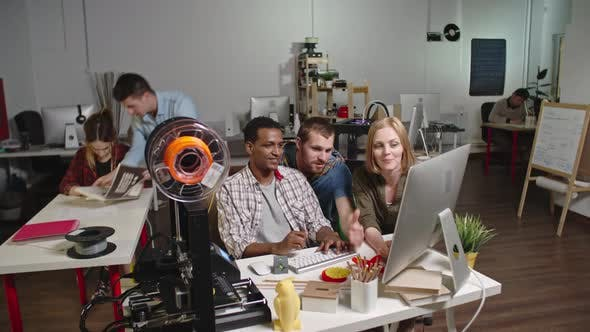 Thumbnail for Engineers Discussing 3d Printing Project in Workshop